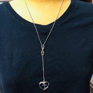 Jewelry - Silver tone cross inside a heart slide necklace